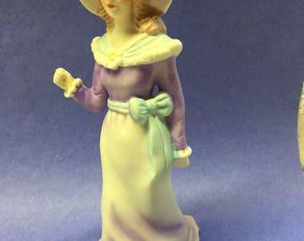 Vintage porcelain lady figurine in purple