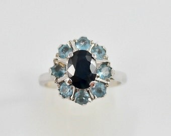 Silver ring with Topaz and spinels