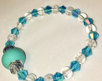 Blue sparkly stretch bracelet with clear accent beads. Stretchy One Size
