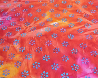 Blue Flower on Red and Orange Batik Cotton Fabric