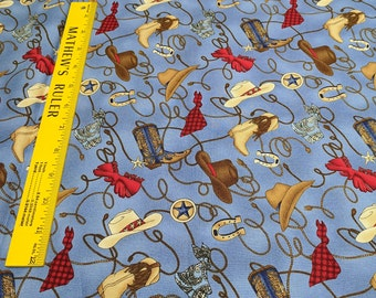 Rodeo Roundup-Hats and Boots on Blue Cotton Fabric from Northcott Fabrics