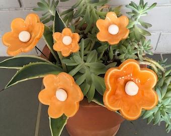 White ceramic and enamel orange flowers