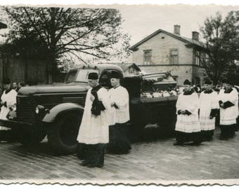 Strange 1940s Soviet funeral procession with truck instead of hearse, coffin, Catholic priests, mourning photo cemetery post mortem snapshot