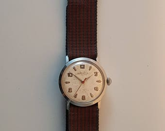 Vintage midi sized RODANIA watch for him or her circa ealry 1960's--------SERVICED-----