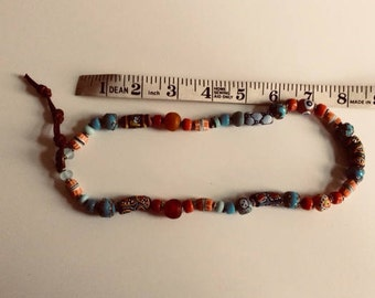 Multi coloured Boho-chic necklace handmade with trade beads. For festivals and summer wear.