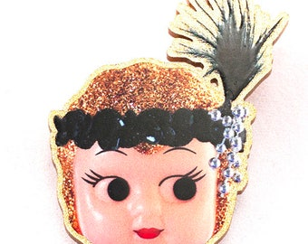 Kewpie Queen brooch - flapper gold