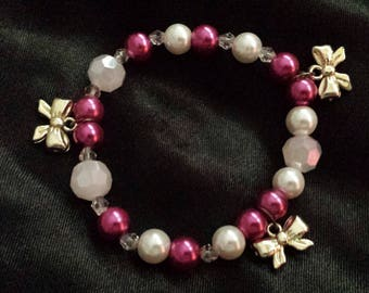 Glass beaded Bow charm bracelet