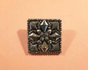Mid to late 19th Century silver and black glass button.
