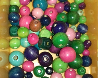 set of 100 beads in wood colors, shapes, sizes
