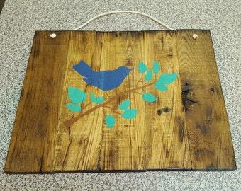 handcrafted bird door hanging