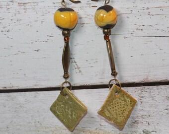Yellow raku, bronze bead, lichen green pearl earrings
