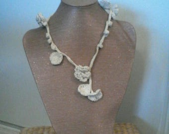 Necklace is crocheted in cotton, flowers, leaves and Bobbles