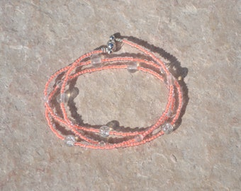 salmon and clear bracelet
