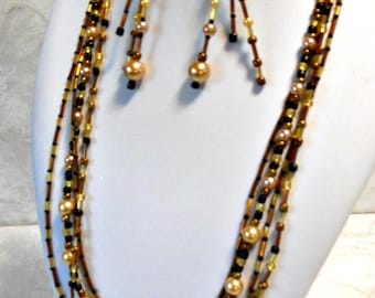 Handmade necklace with brown tubes, golden pearls