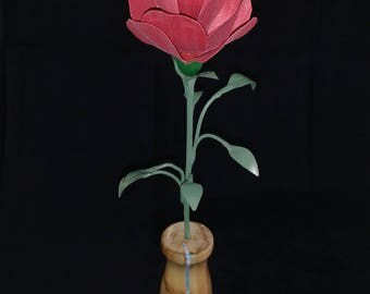 Wooden red rose and detailed metal stem, in a spalted maple vase with blue and white accents.