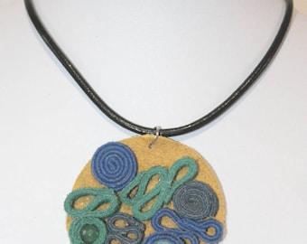 Leather pendant with semi-precious stones.