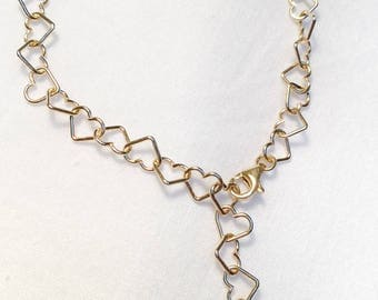 Bracelet Hearts braided in gold-colored silver