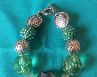 Teal and green with sliver accents beaded bracelet