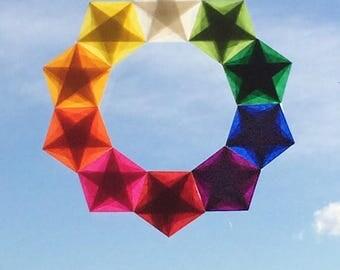 I love this Ring of Stars. Blessings Everyone! -- Waldorf Window Stars, Christmas Wreath, Paper Wreath. Rainbow Stars -- Handwork Studio