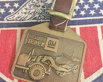 GM Terex Scraper Advertising Watch Fob Construction Equipment  Vintage Brass  New Old Stock with Leather Strap