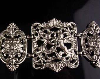 RARE Antique bracelet / silver haunted gargoyle and Angels / medieval Italian putti / Victorian statement bracelet / Renaissance Queen