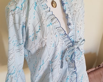 light fall jacket, lightweight jacket, blue lingerie, delicate blossom print, flared sleeves, pale blue jacket