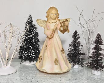 Vintage Revolving Angel Music Box Statue for Christmas. Revolves & plays Silent Night. Spinning, Twirling action.