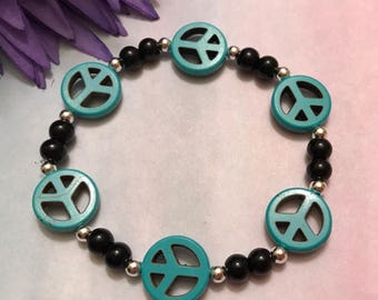 peace sign bracelet, teal and black, howlite, glass, silver, stretch bracelet, 7.25 inches