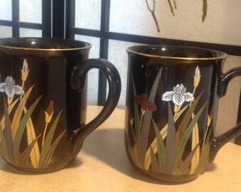 Pair of black  Otagiri Japan coffee cups, Iris flower pattern on black, gold embellished