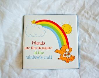 80s Care Bears trivet - Vintage Friend Bear -  cheesy sliding on a rainbow - Friends are the treasure at the rainbow's end !