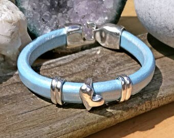 Metallic blue regaliz liquorice leather cuff bracelet. Mens wear,womens wear. Silver plated heart charm and hook clasp.gift for her or him