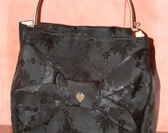 Retro evening bag has black bow