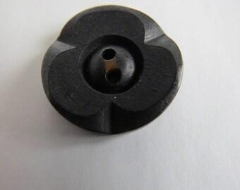 Large vintage black embossed button