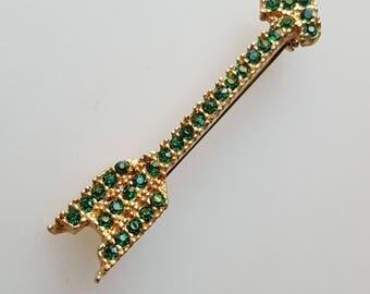 Vintage green arrow pin rhinestones on gold-tone metal