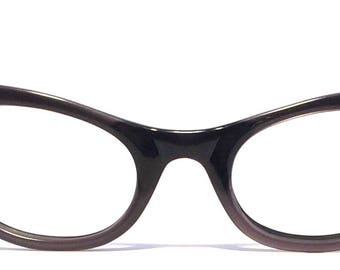 Vintage eyewear. Cat eye style. Very cool dimensional design on corners. Gloss black with a touch of grey. Made in USA 1960's. Hip Urban