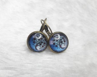 Earrings cabochon round blue cosmic trees