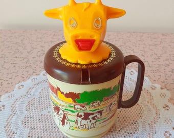 Vintage plastic cow creamer and mug
