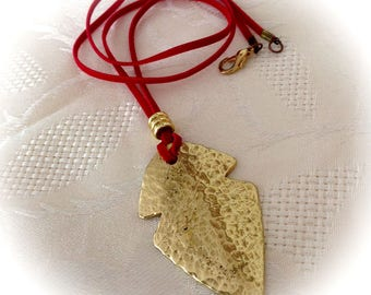 Necklace, brass, gold, red.