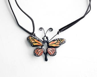 Unusual Primitive Monarch Butterfly Necklace, Hand Painted Clay Butterfly Wings and Wire Wrap Pendant on Faux Suede Cord Boho Jewelry