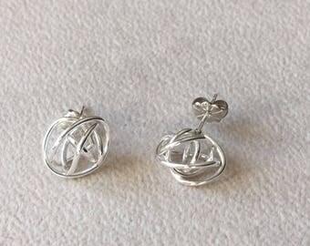 """Dainty """"love knot"""" sterling silver post earrings."""