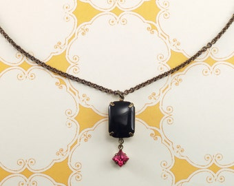 Black and pink crystal dangle pendant