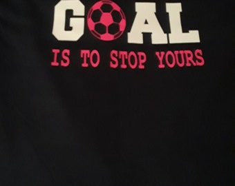 Soccer Shirt. Front and back. Sport shirts with saying on the back and symbol with players name on the front.