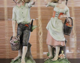 French Bisque Figures of Man and Woman Bearing Fruit