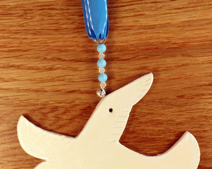 Featured listing image: White Seagull Pottery hanging Decoration, a great gift for somebody who loves the beach. Which will arrive in a white gossamer bag.