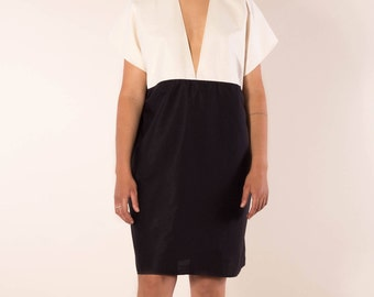 Simple, elegant dress with deep V-neck in black organic cotton with white, summer dress