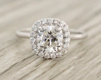 Cushion Brilliant in a French Pavé Halo Polished Shank Engagement Ring in White