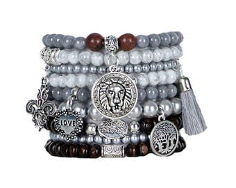 Beaded Bracelets Set of 9 Stretch Bracelets Bohemian Themed Stack with Silver Tone Charms and Tassel