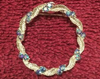 Silver tone vintage costume brooch w/blue stones