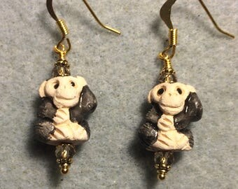 Small black and gray ceramic monkey bead earrings adorned with gray Chinese crystal beads.