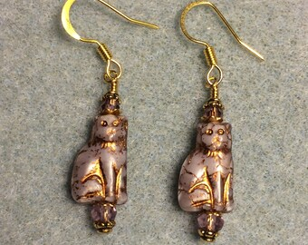 Small violet Czech glass cat bead earrings adorned with violet Chinese crystal beads.